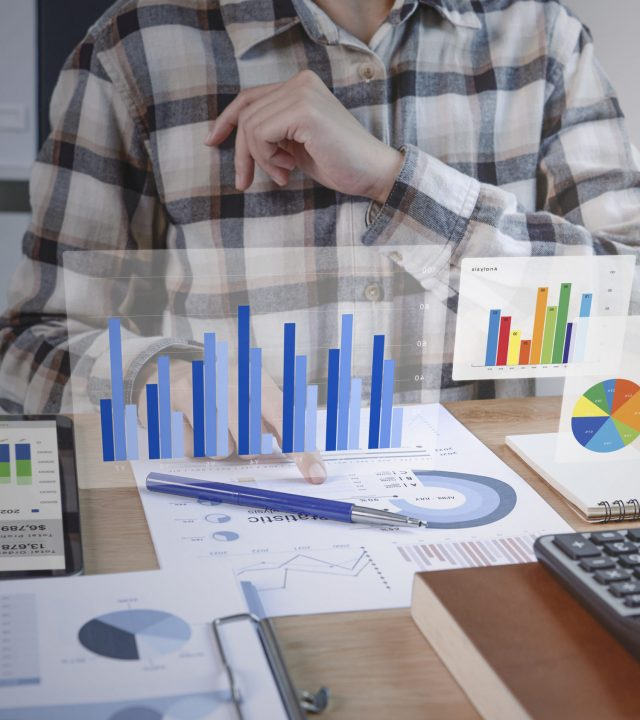 Businesspeople working in finance and accounting Analyze financial graph budget and planning for future in office room.
